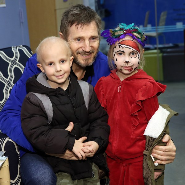 Liam Neeson Spreads Holiday Cheer
